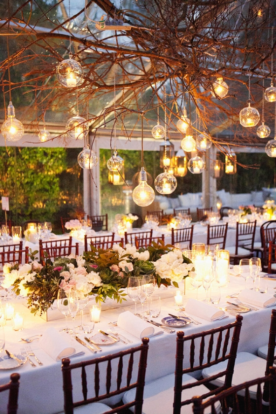 Communal tables with white table cloths...and a tree branch chandelier