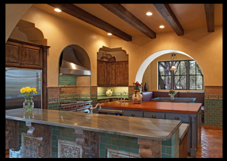 Pure Mediterranean style - down to the exposed beams, coloured tile and orange walls. VIa Houzz.