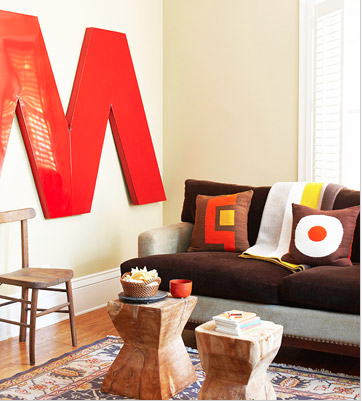 Neutral tones with a pop of red and yellow, via Better Homes and Gardens