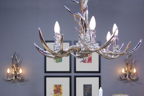 An antler chandelier with a more modern vibe. Great for a dining room. Via Universal Lighting.