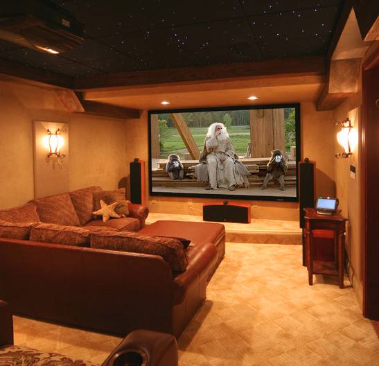 Easily convert your basement into a comfy media room, complete with couch, projector screen and starry ceiling. via Houzz.