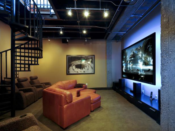 Enough seating for you and your friends, plus awesome mood lighting behind the big TV. via HGTV.