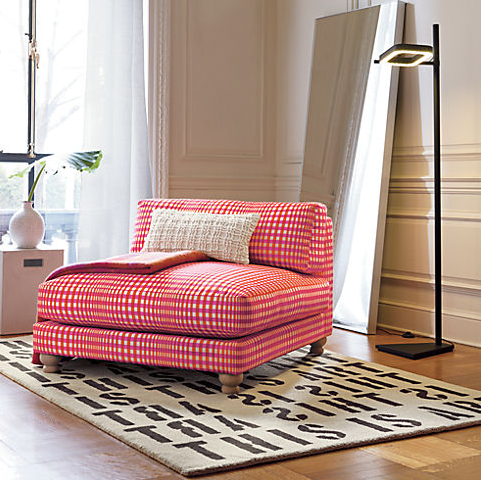 Couch: bold gingham against a muted, neutral background
