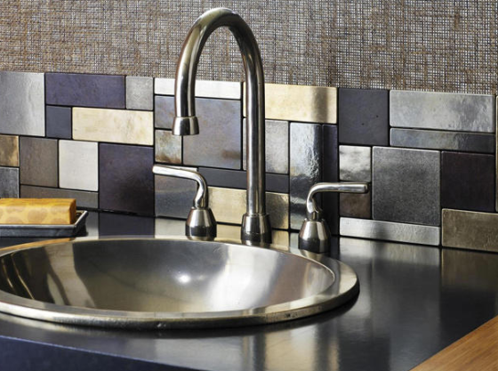 Modern Metallic: for a much more modern look, this backsplash pops. It's enough to just have a section of it rather than have it cover your whole wall. via HGTV.