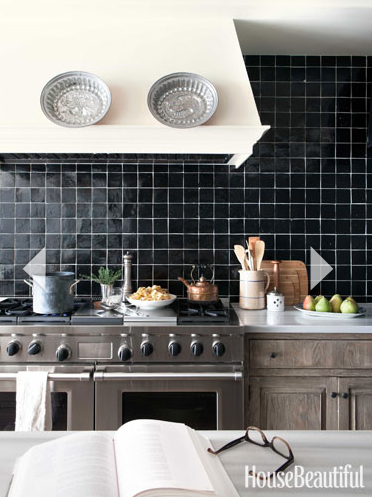 Bold and Black: For a completely bold look, all black tiles do the trick. Against stainless steel appliances and a white/light kitchen, you're making quite a statement. via House Beautiful.